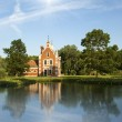 Little church with beautiful lake and forest — Stock Photo #24686183