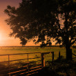 Rural scenery in sunset with ray of sunshine — Stock Photo