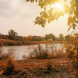 Idyllic autumn landscape with lake — Stock Photo