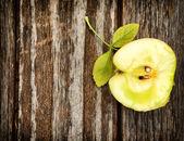 Apple on wooden background — Stock Photo