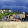 Old train and medieval village — Stock Photo