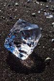 Ice block on the sand — Stock Photo