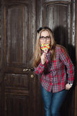 Beautiful girl in plaid shirt and glasses — Stock Photo