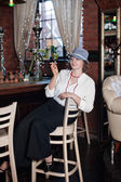 Woman smoking cigarette in restaurant — Foto Stock
