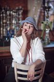 Woman smoking cigarette in restaurant — Stockfoto