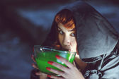 Witch with poison in bowl — Stock Photo