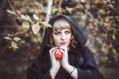 Woman in witch costume — Stock Photo