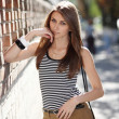 A girl in a striped T-shirt  — Stockfoto