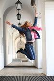 Girl jumping for joy — Stock Photo