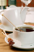 Cup of tea and a crystalline brown sugar — Stock Photo