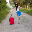 Young womhitchhiking — Stock Photo #22360885