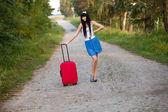 Young woman hitchhiking — Stock Photo