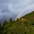 Rainbow over the mountainside — Stock Photo