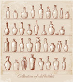 Sketches of old bottles in vintage style. — Stock Vector