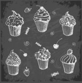 Sketches of cupcakes on blackboard. — Stockvector