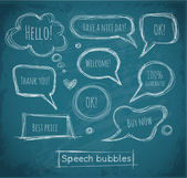 Speech and thought bubbles on blackboard. — Cтоковый вектор