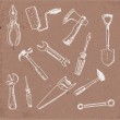 Tools hand drawn on brown paper. — Stock Vector