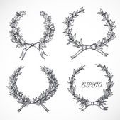 Laurel wreaths isolated on white. — Vector de stock