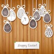 Easter card with eggs on wooden background. — Stock Vector