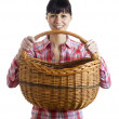 Pretty woman and wicker basket - Stock Photo