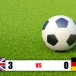 Scoreboard and soccer ball on grass field — Stock Photo