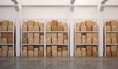 Warehouse with many stacked boxes on pallets — Stock Photo