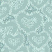 Seamless pattern with hearts lined with snowflakes — 图库矢量图片