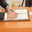 Groom Signing Marriage Certificate — Stock Photo #25269873