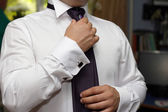 Groom fixing his tie — Stock Photo