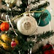 New Year's toys on a fir-tree — Stock Photo