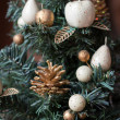 Stock Photo: New Year's toys on a fir-tree