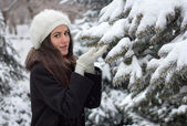 Cheerful Caucasian Young Woman in Snowy Weather holds a snow bra — Stockfoto