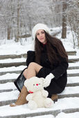 Cheerful Caucasian Young Woman in Snowy Weather holds a toy — Stock Photo
