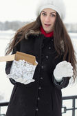 Cheerful Caucasian Young Woman in Snowy Weather is surprised to — Foto Stock