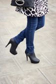 Girl's leg with black boots on a high heel. — Stock Photo