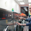 Laundromat girl — Stock Photo #19365159