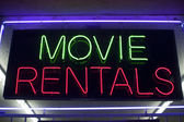 Movie rentals neon — Stock Photo