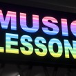 Stock Photo: Music lessons sign