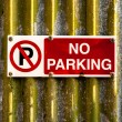 No parking sign on metal texture — Stock Photo