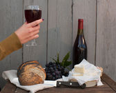 Wine, bread and camembert — Stock Photo