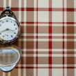 Pocket watch on  table cloth — Stock Photo