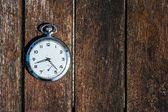 Retro pocket watch on wood — Stock Photo