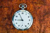 Pocket watch on rust — Stock Photo