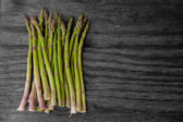 Asparagus on black and white texture — Stock Photo