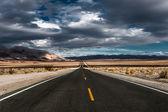 Stormy desert highway — Stock Photo