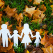 Paper family in autumn grass  — Stock Photo