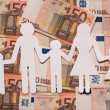 Paper family on euro notes — Stock Photo