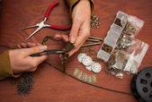 Hands making craft jewellery — Stock Photo