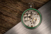 Pocket watch mechanism on abstract background — Stock Photo