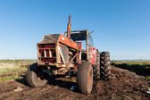 Tractor in a peat bog field — Stock Photo